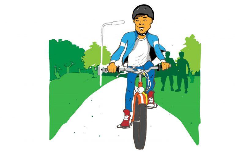 Pål cyklar på en cykelbana iklädd en blå jacka och röda skor